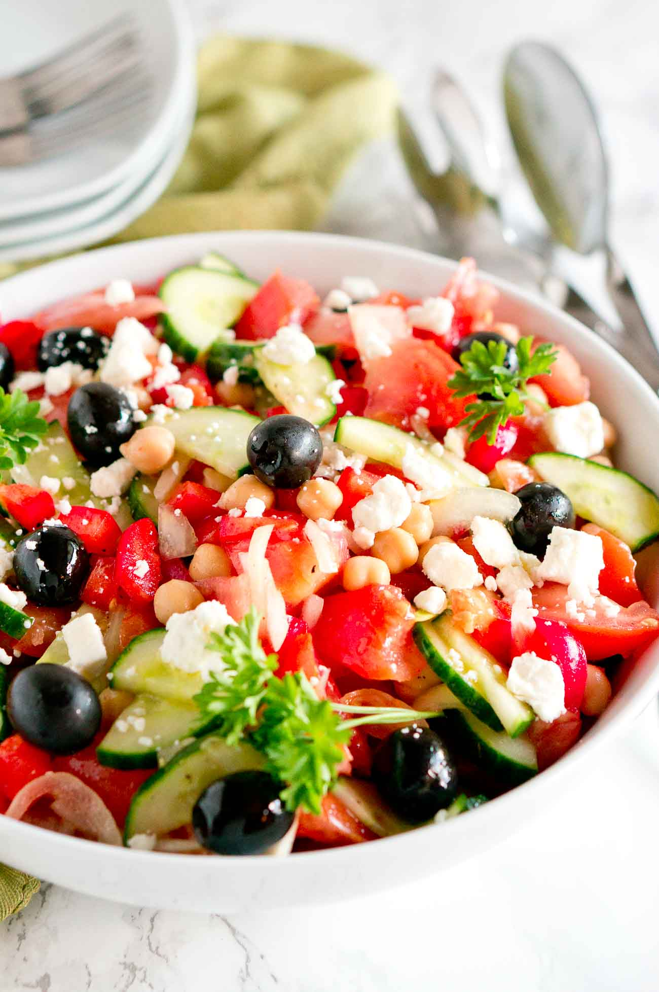 Easy Greek Salad with plates & forks in background