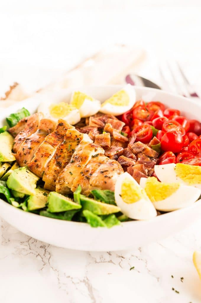 California Cobb salad made with chicken, bacon, tomatoes, avocados and eggs
