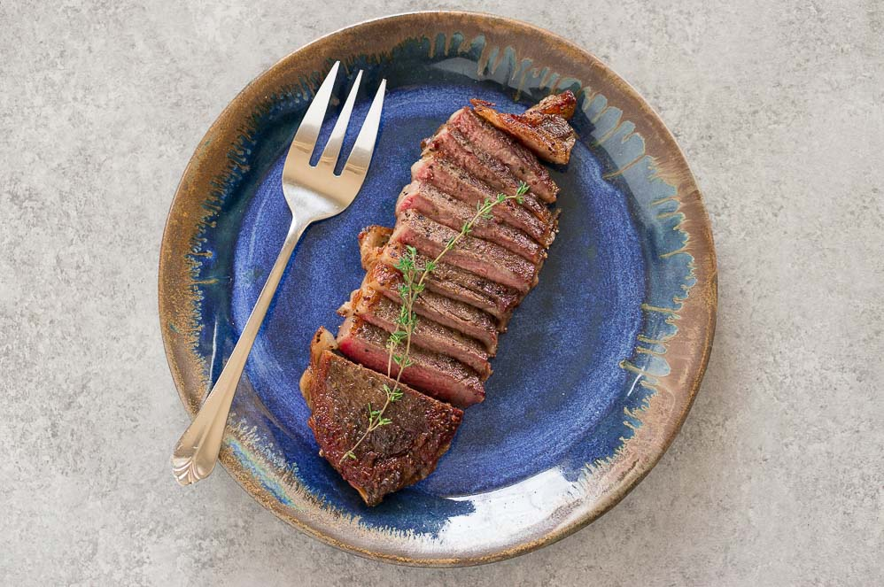 sous vide steak on blue plate