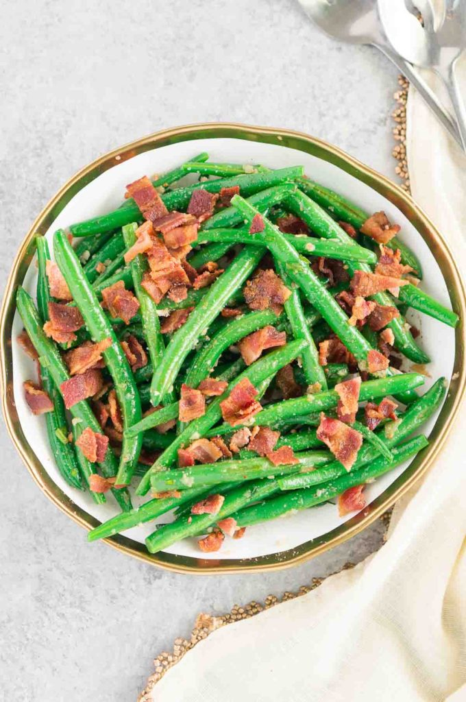 green beans and bacon on a plate