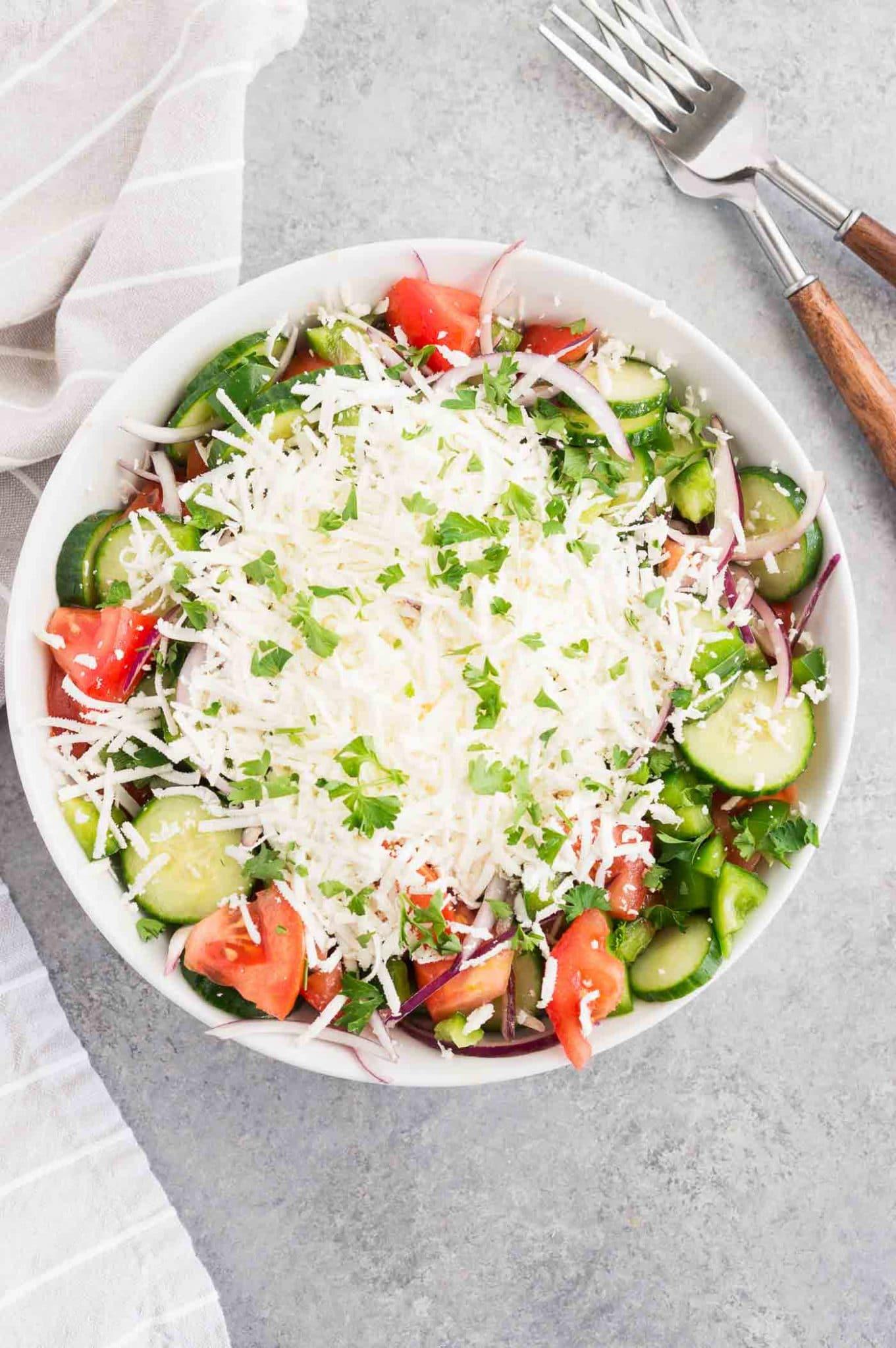 shopska salad - bulgarian salad with feta cheese in a bowl