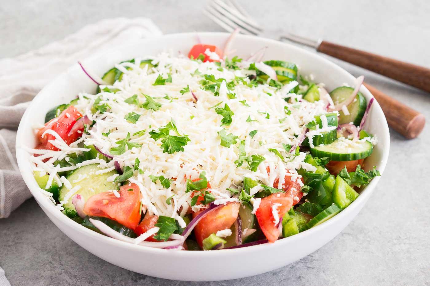 shopska salad in a white bowl