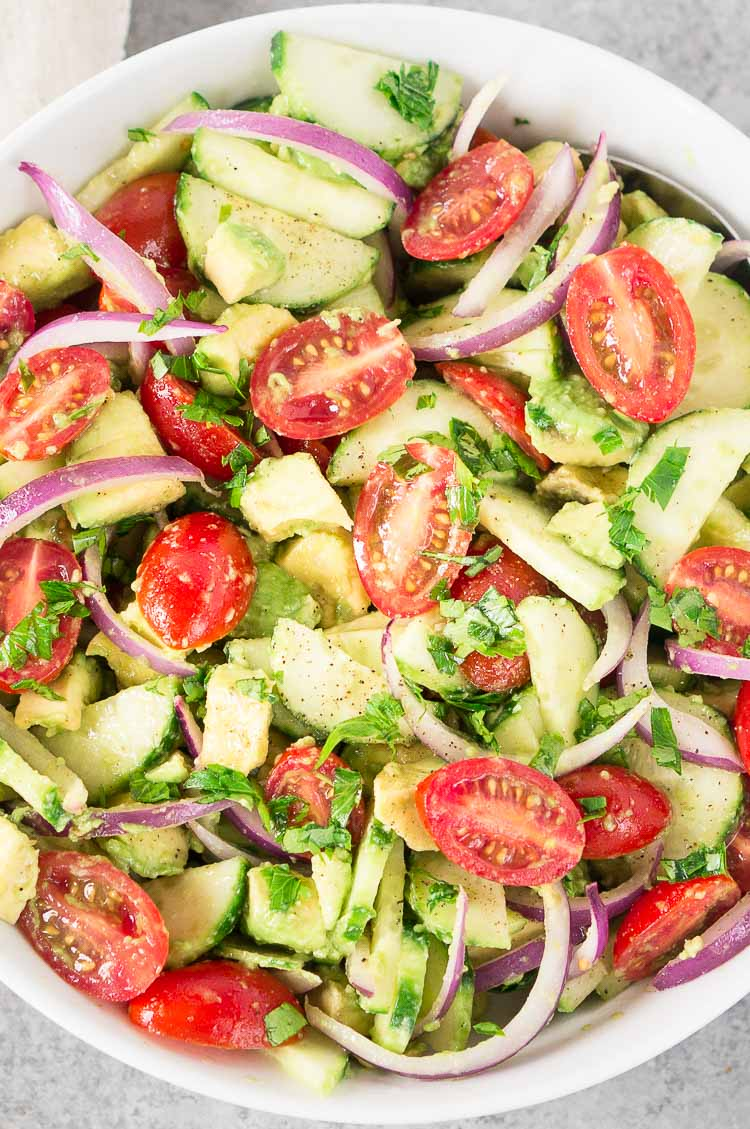 Tomato cucumber avocado salad in a bowl
