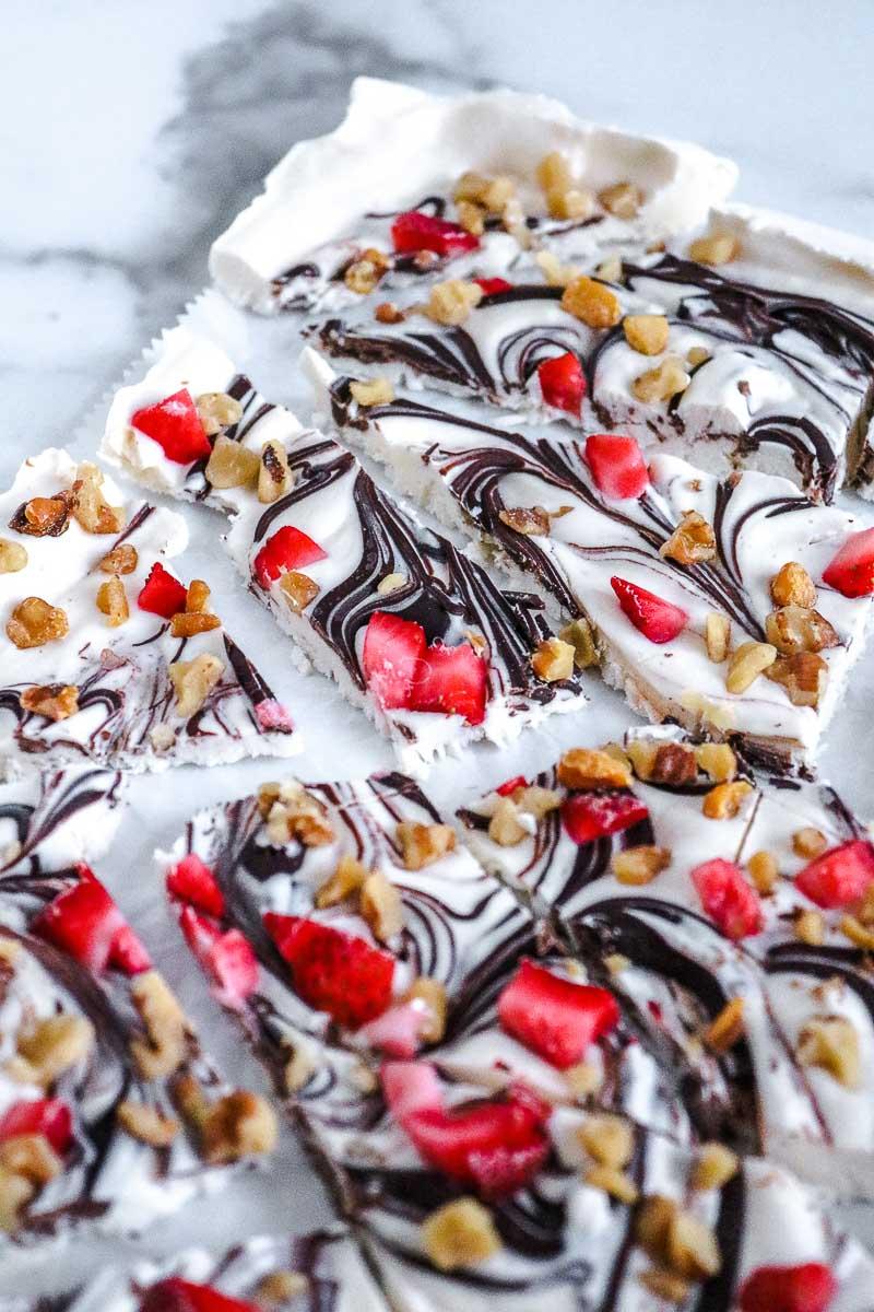 frozen yogurt bark pieces with strawberries and chocolate