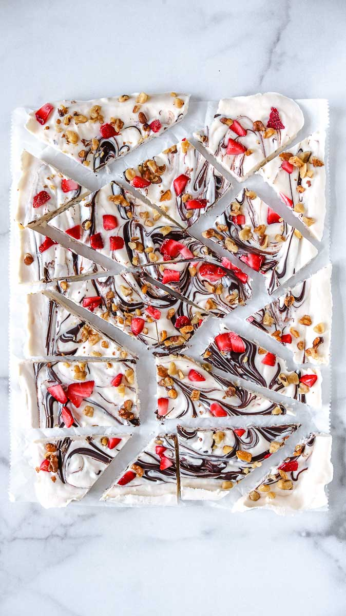 keto yogurt bark topped with strawberries chocolate and walnuts
