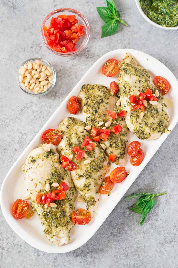 above shot of pesto chicken bake on a white plate