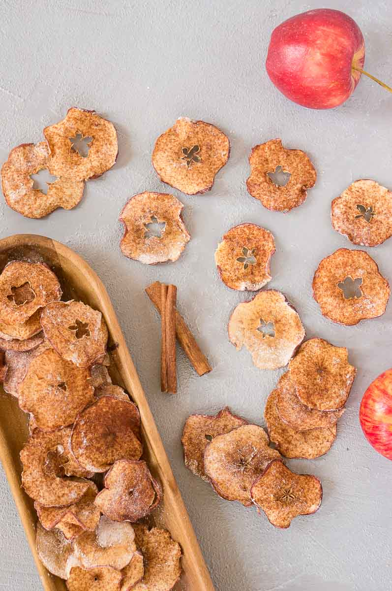 apple chips baked in the oven served on a wooden platter