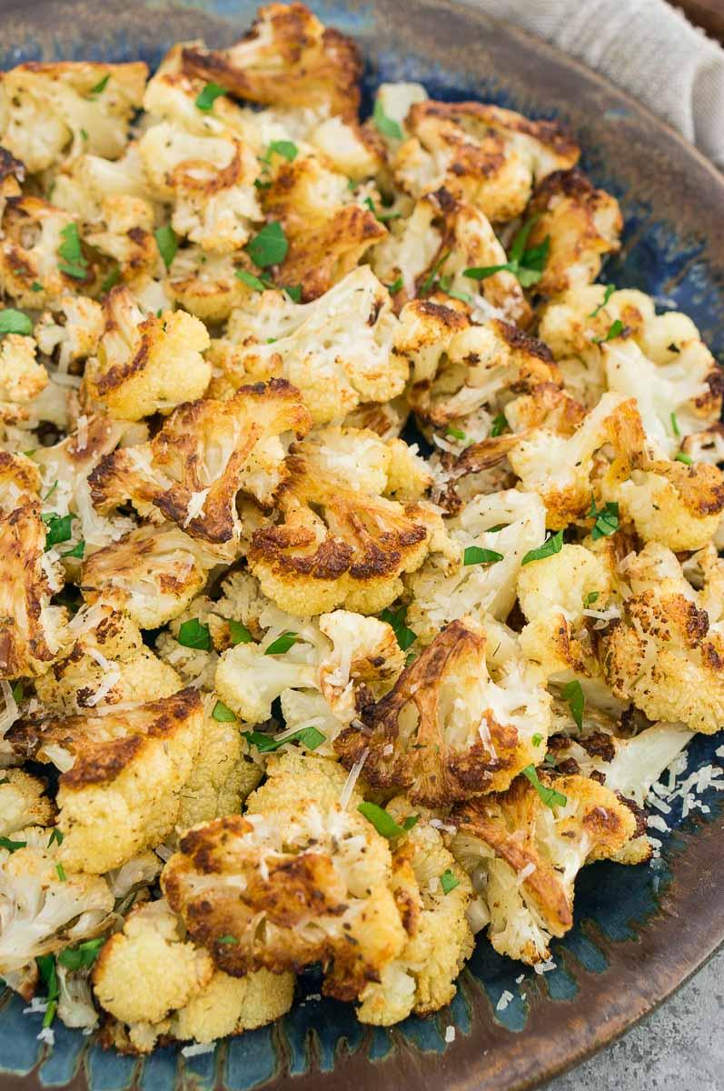close up shot of roasted garlic cauliflower in a plate