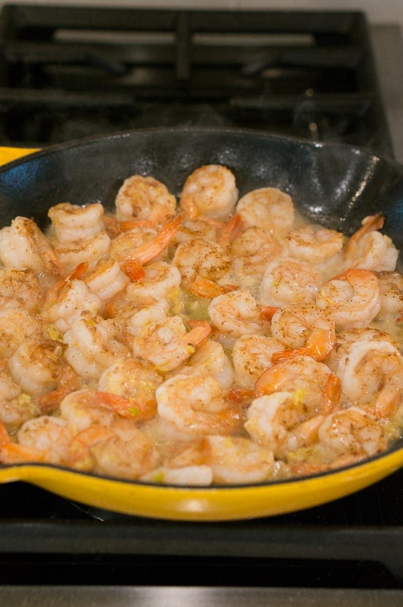 making shrimp scampi on the stove