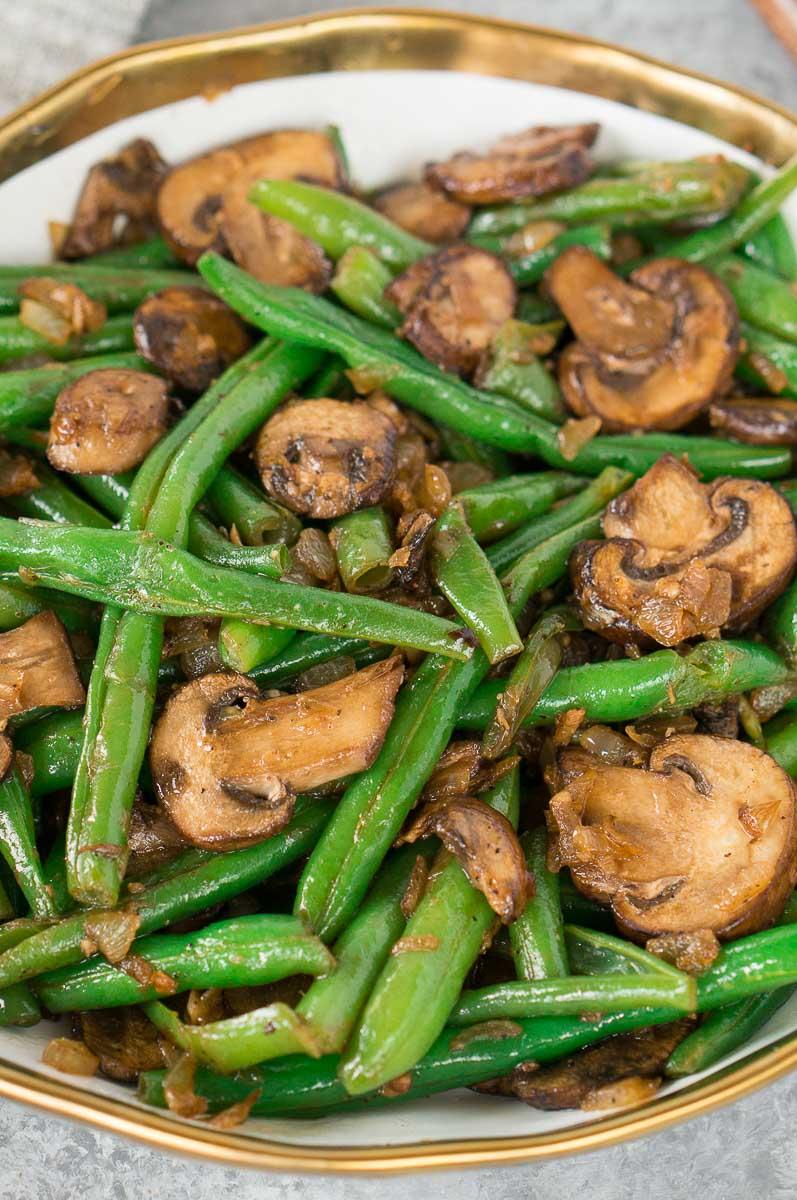 close up shot of green bean recipe with mushrooms
