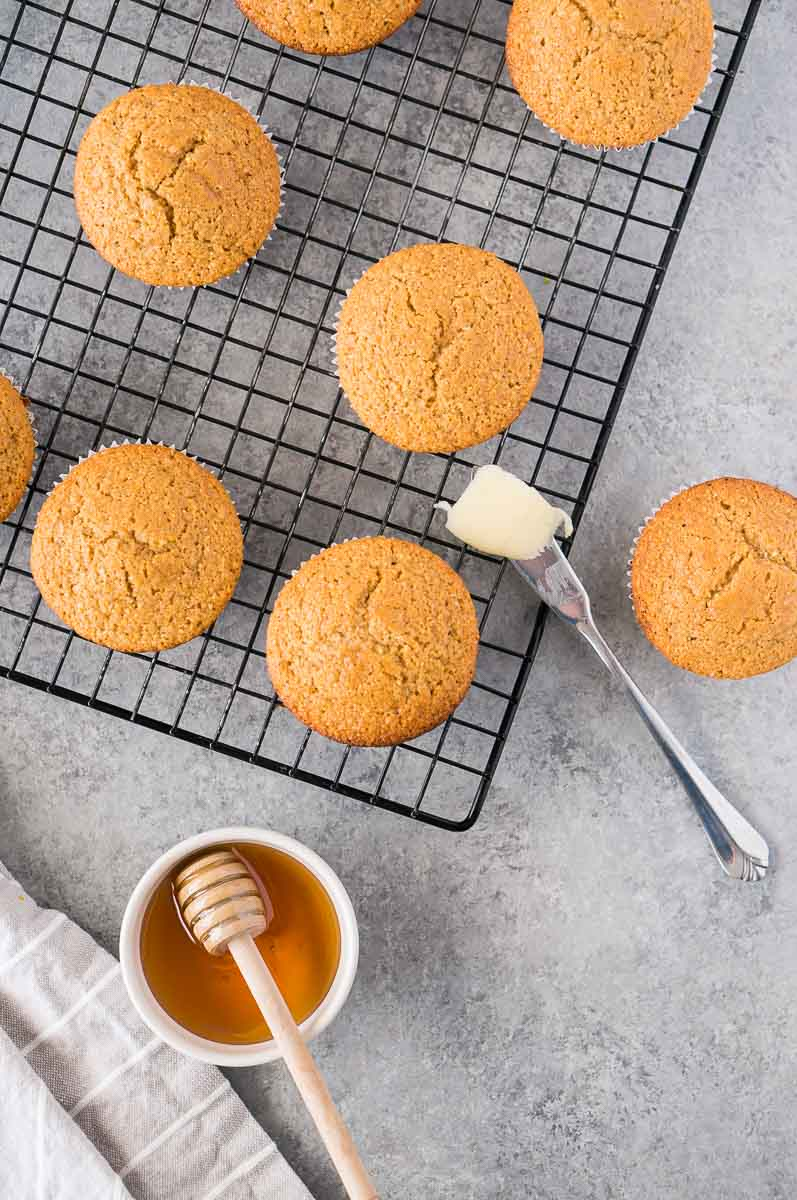 gluten free cornbread muffins on a cooling rack
