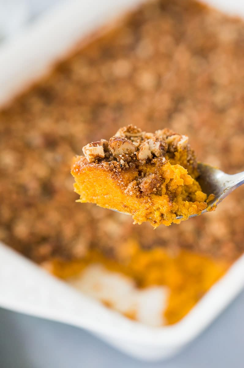 scooping sweet potato casserole with a spoon