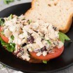 turkey salad sandwich on a black plate