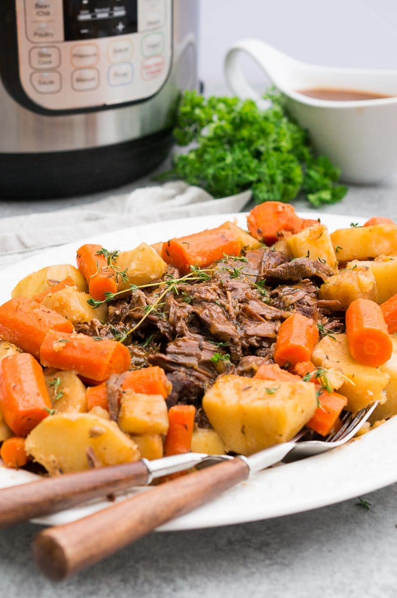 instant pot chuck roast with potatoes and carrots on a plate