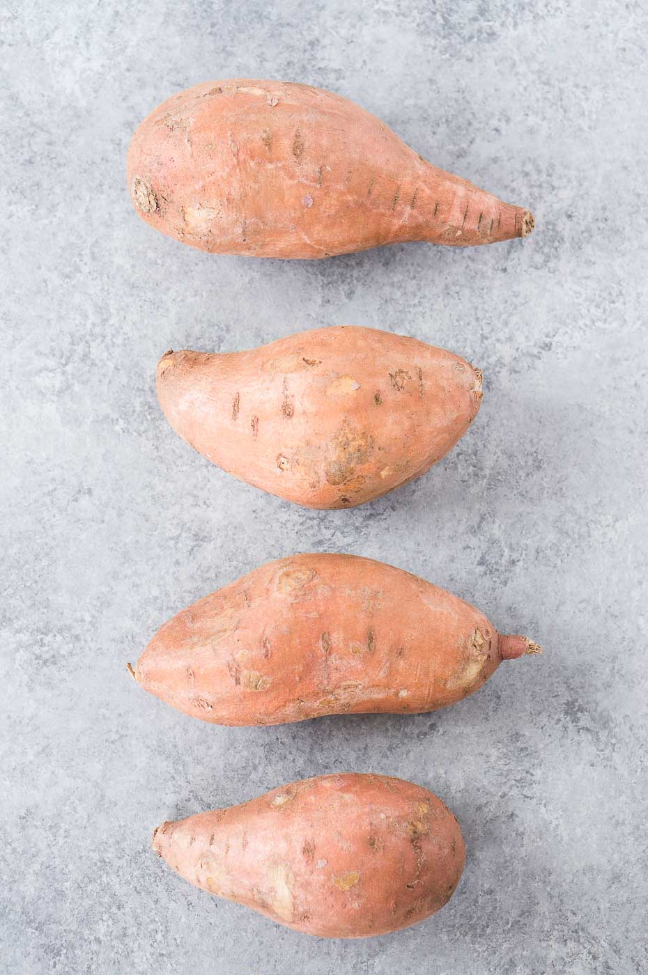 sweet potatoes on a board