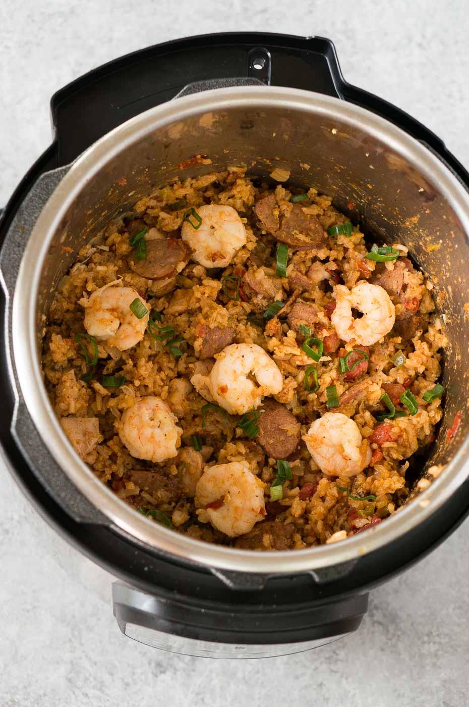 adding shrimp to the jambalaya