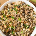 rice dish with mushrooms plated in a bowl