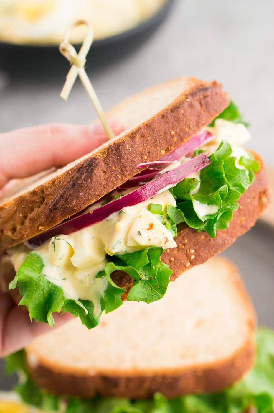 holding a sandwich