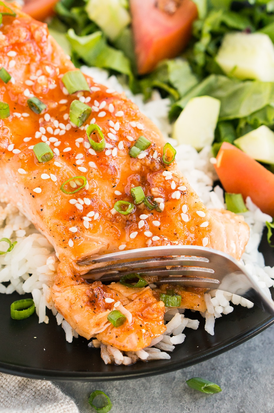 flaking salmon with a fork
