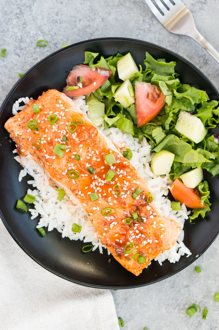 plated baked salmon with sides on a plate
