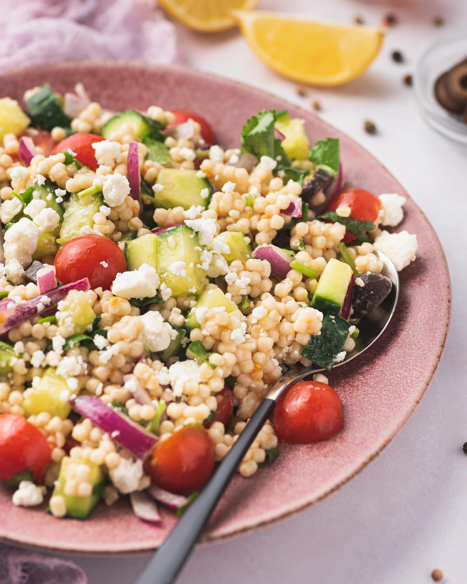 close up of mediterranean couscous salad