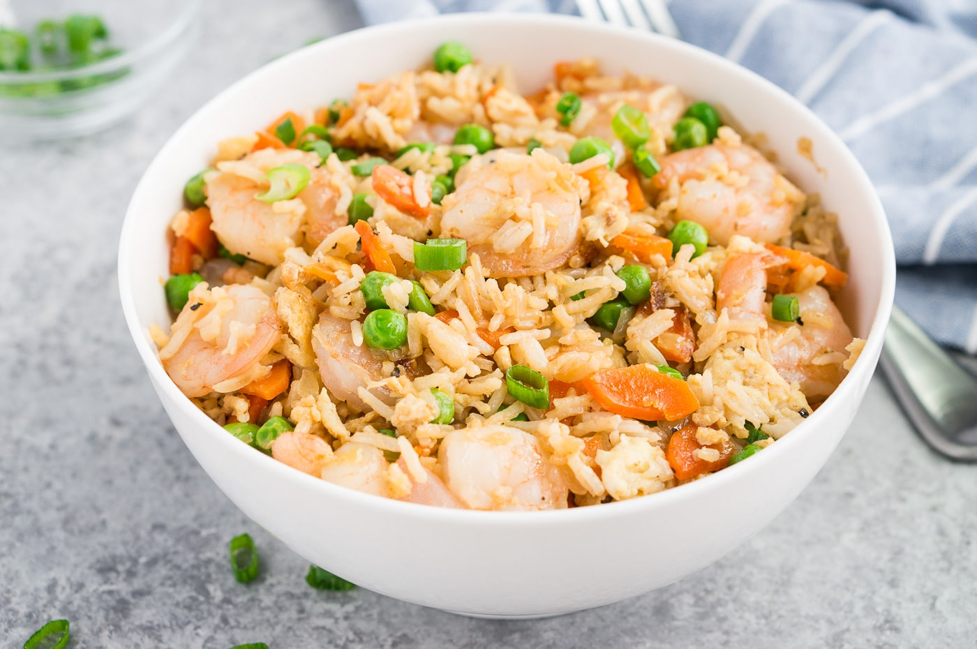 shrimp with fried rice in a white bowl