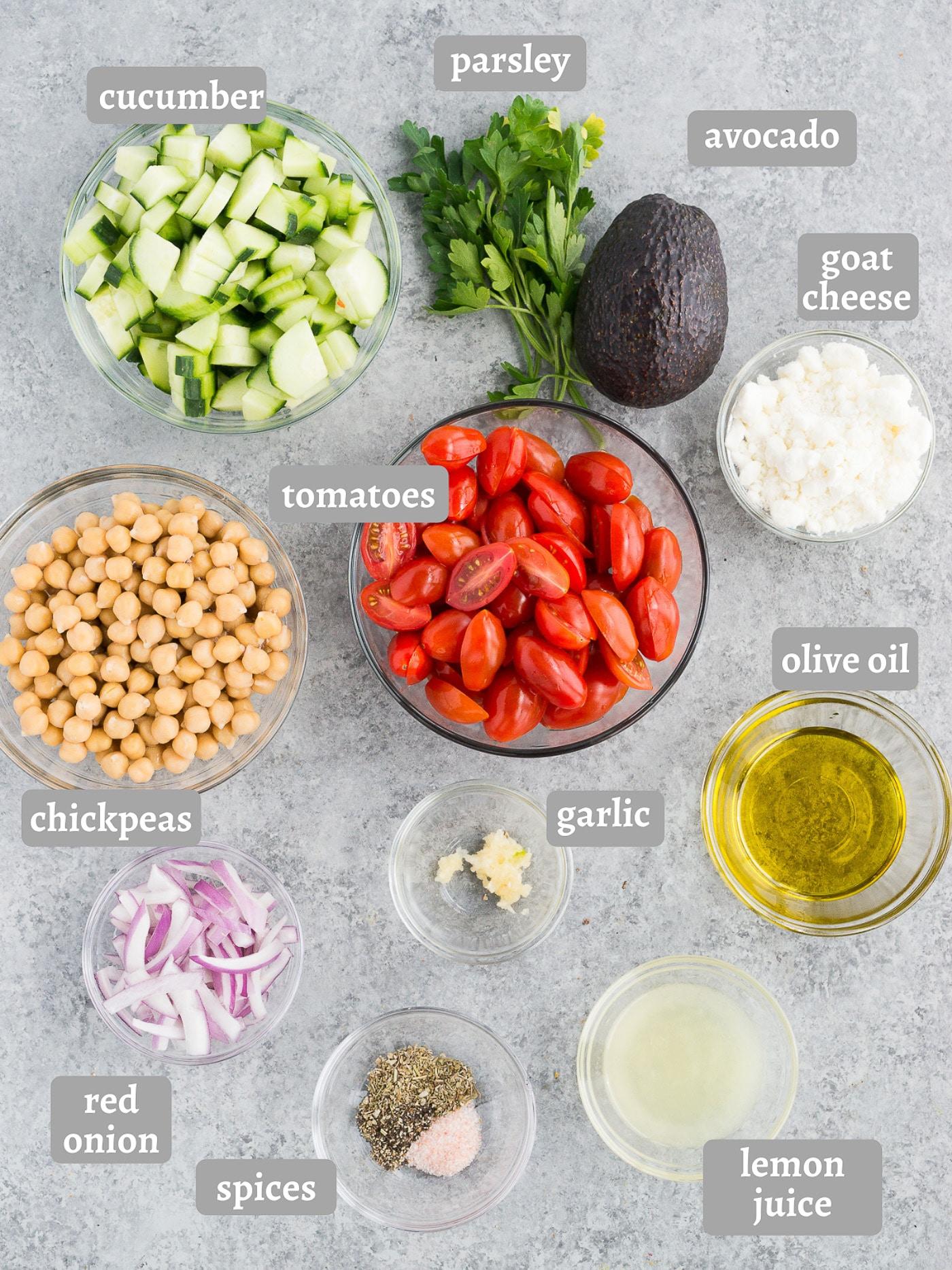 mediterranean chickpea salad ingredients on a board