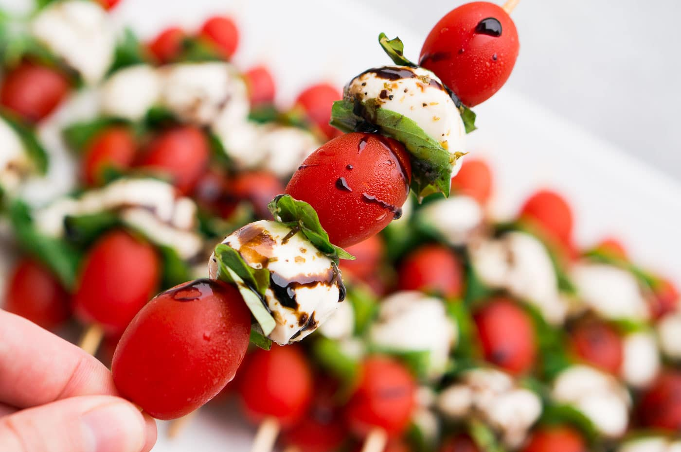 tomatoes mozzarella and basil on a skewer