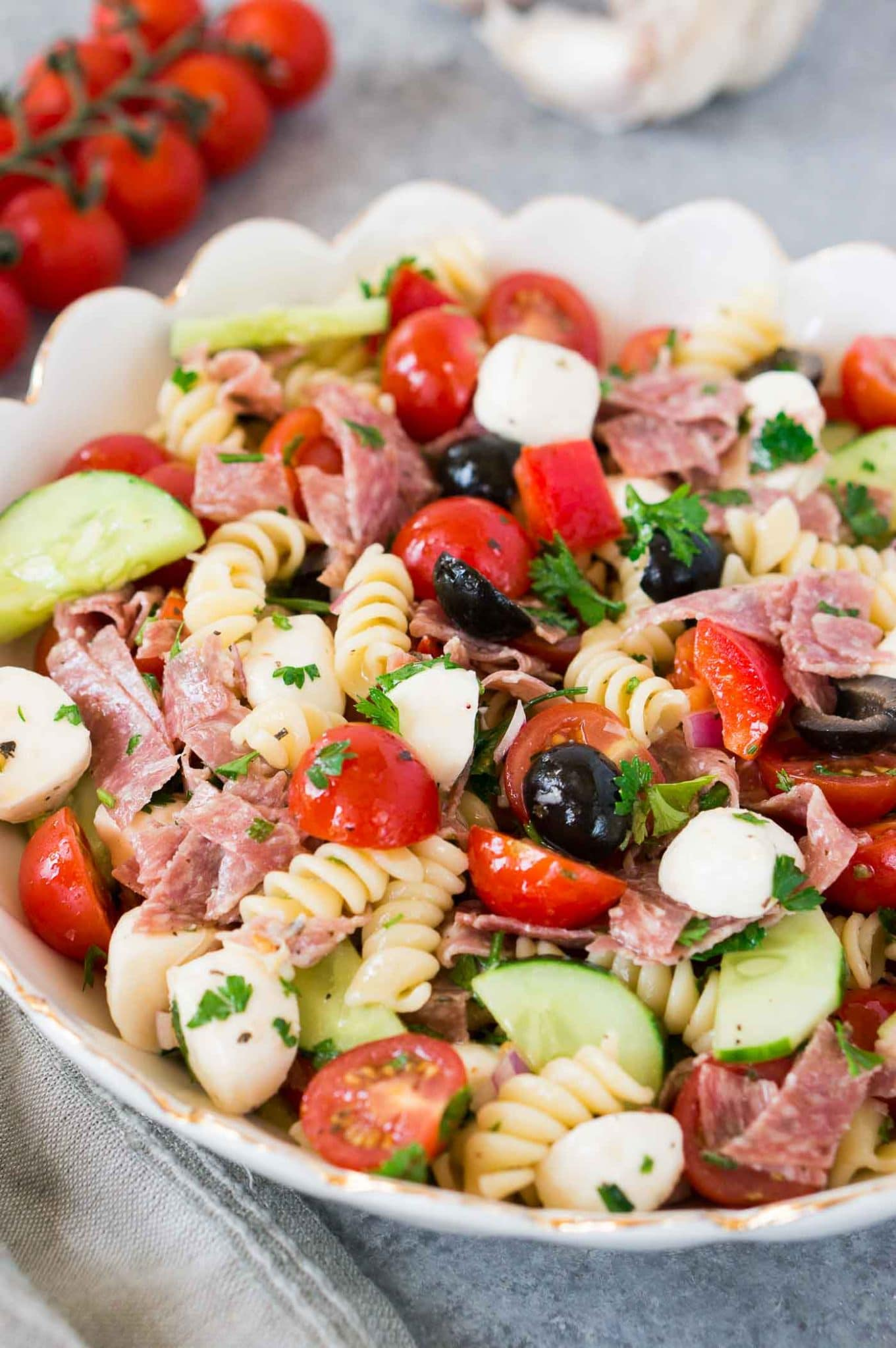 close up shot of a bowl with healthy Italian pasta salad and vegetables