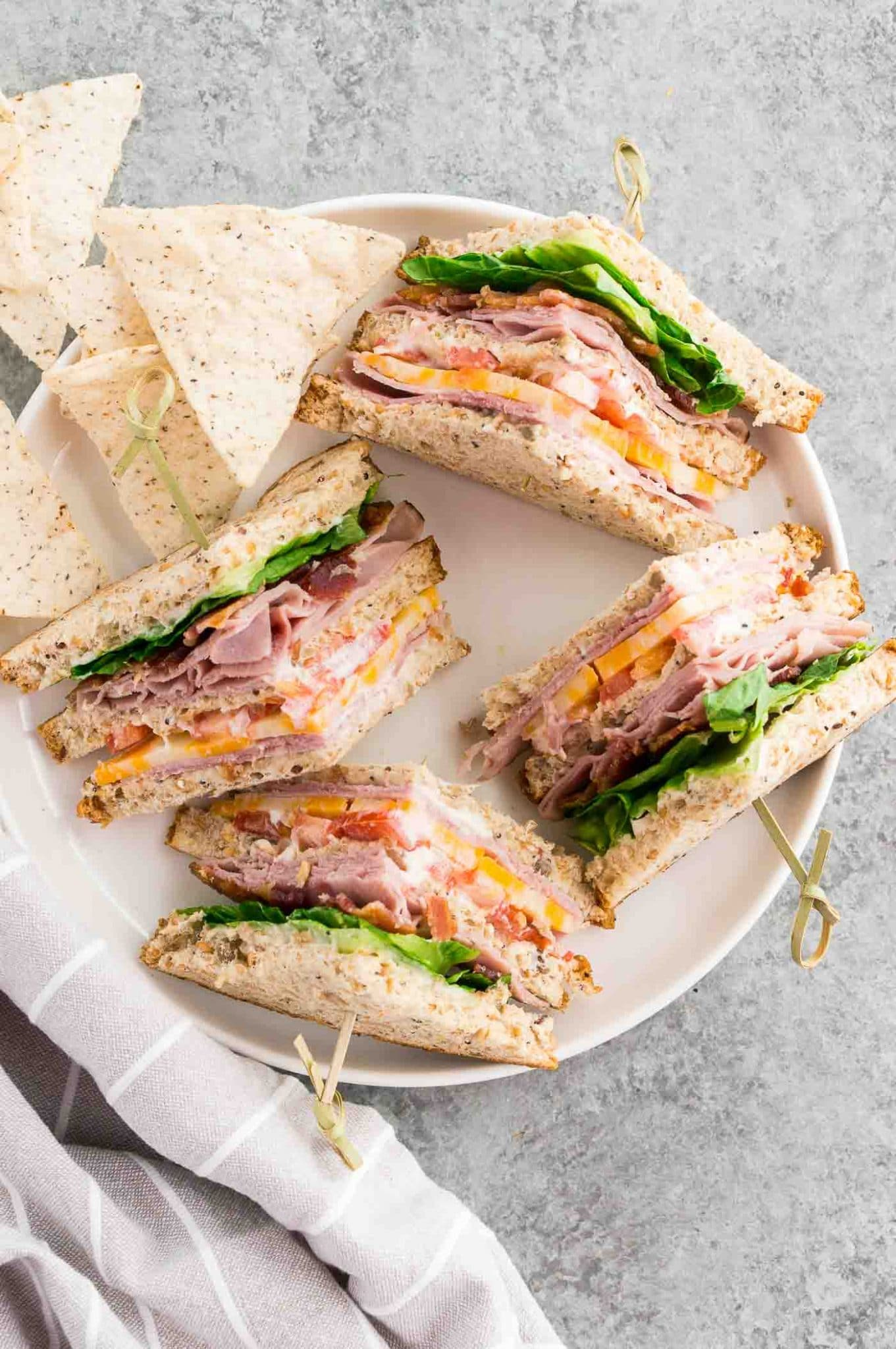 club sandwiches and chips on a plate