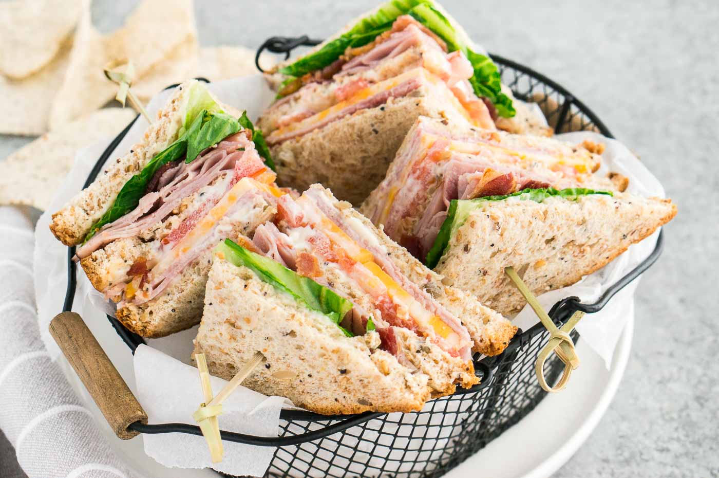 close up image of the best clubhouse sandwiches in a basket