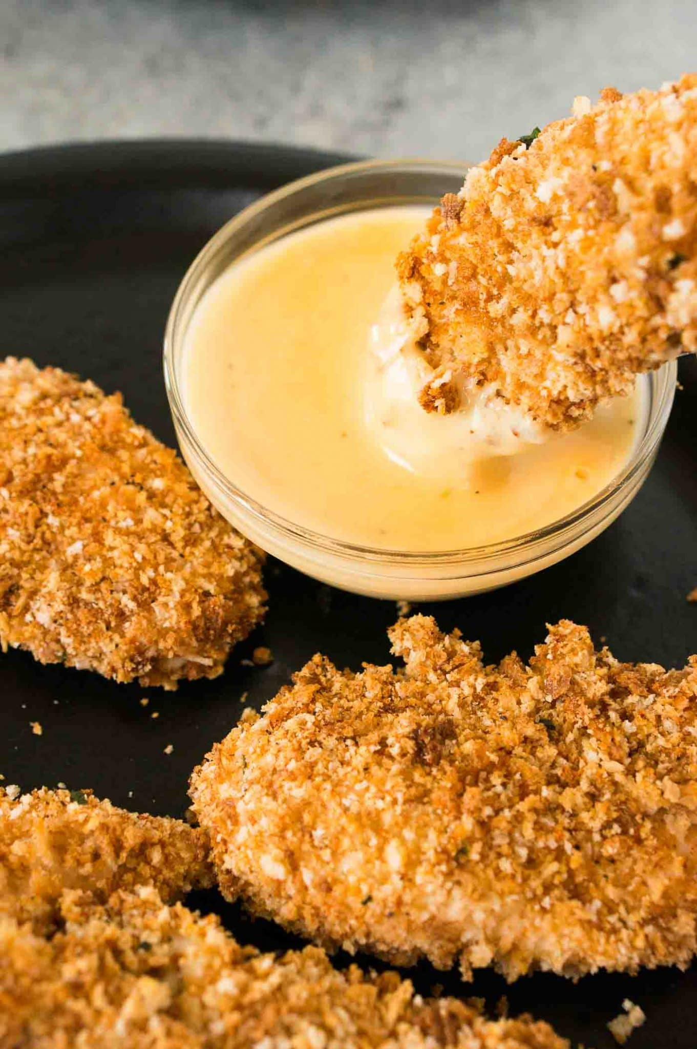 dipping chicken tenders in honey Dijon sauce