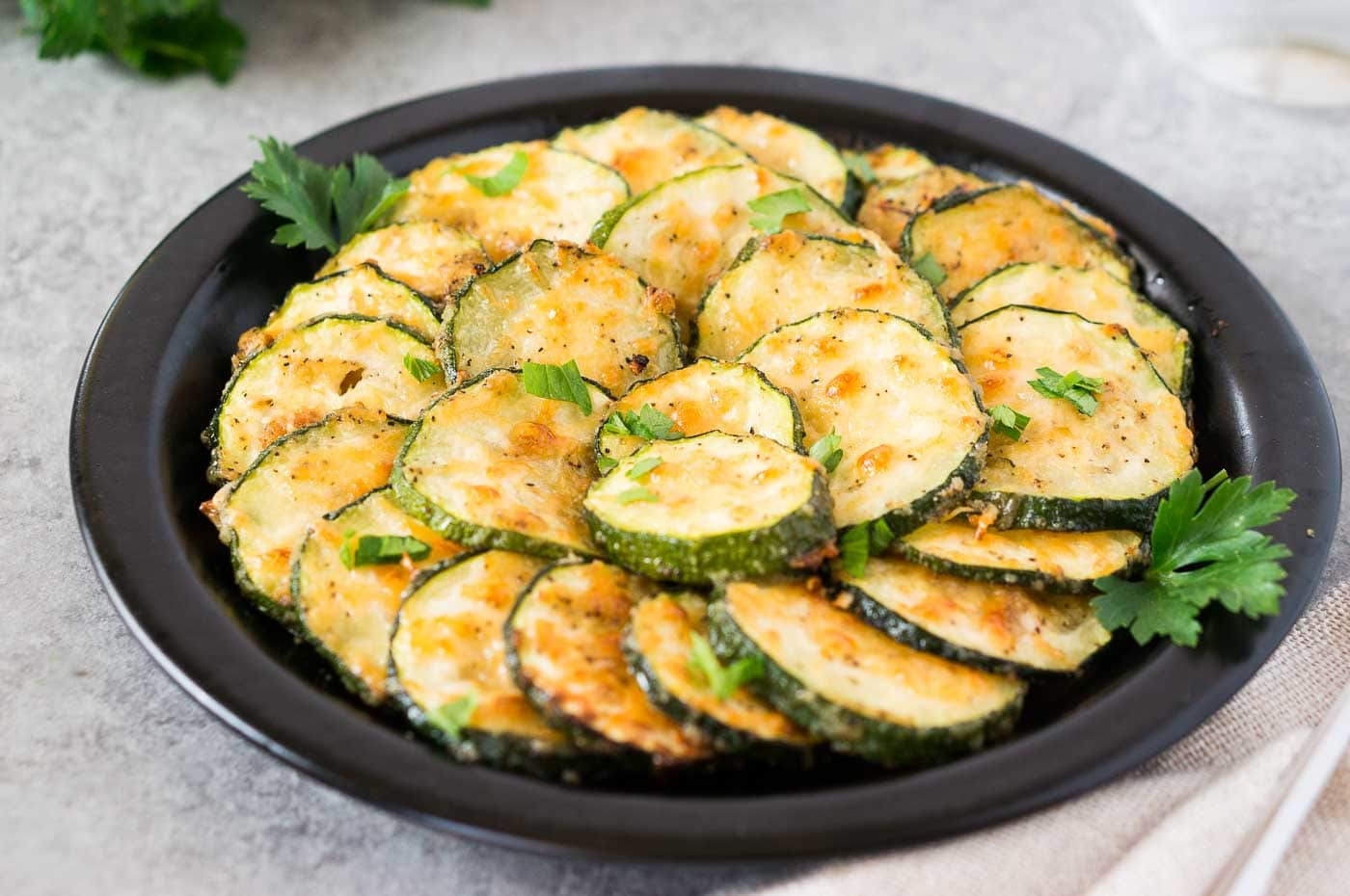 roasted zucchini slices on a plate