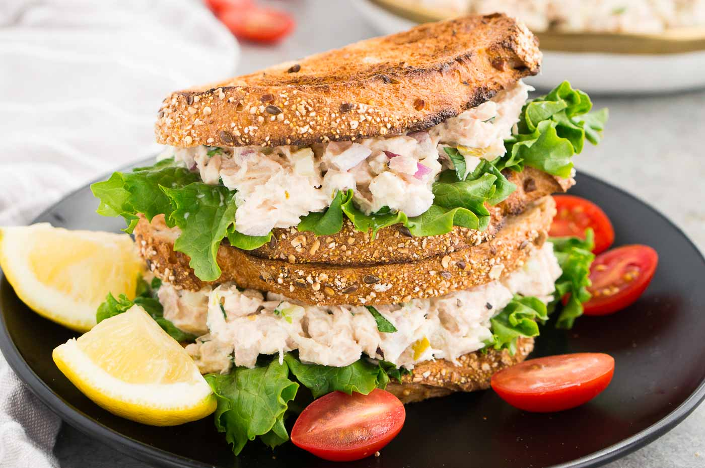 stacked tuna sandwich on a plate