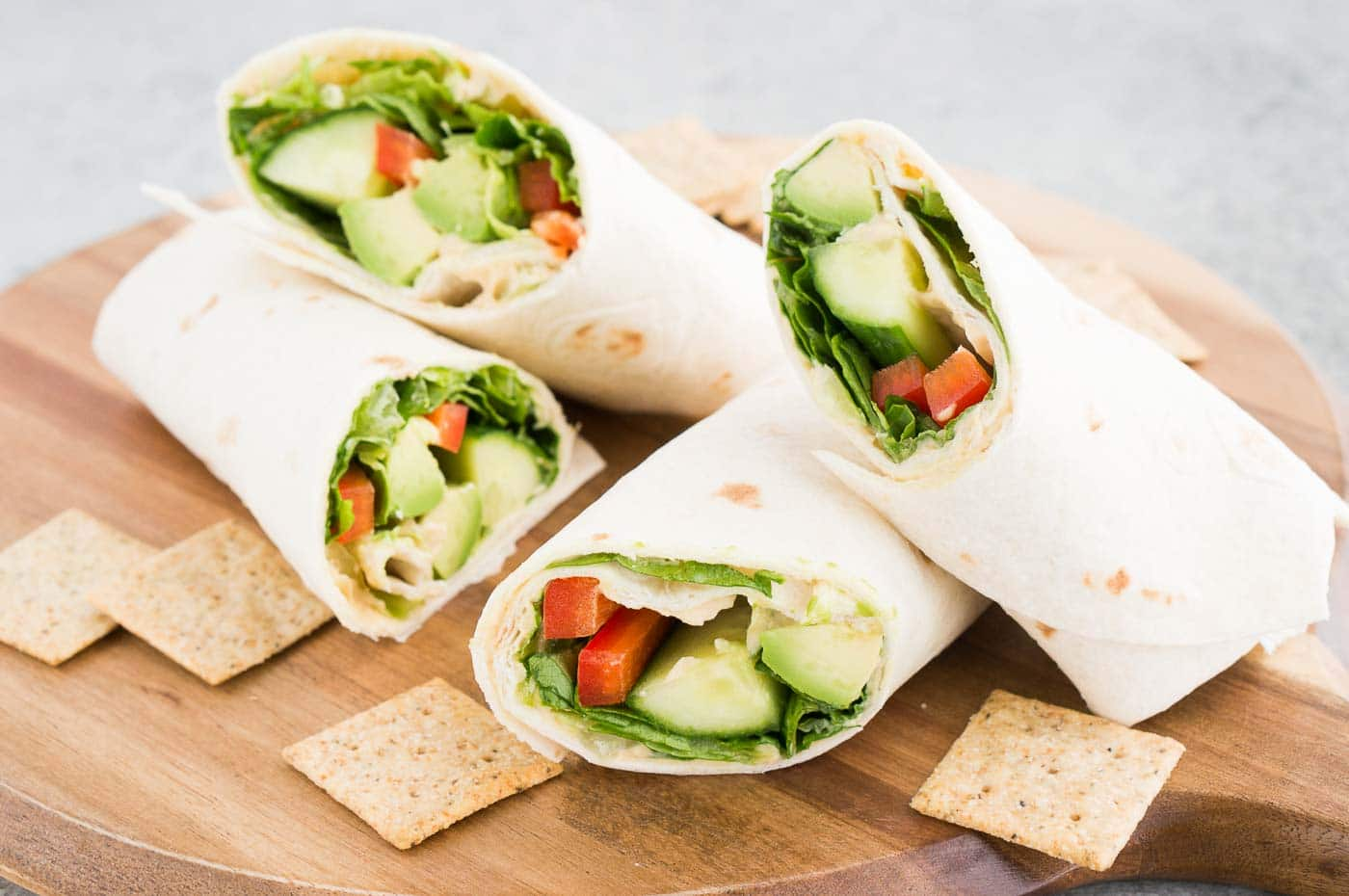 vegetarian wrap and crackers on a board