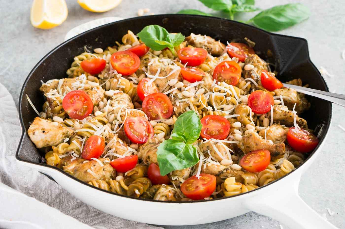 pesto pasta and chicken in a skillet