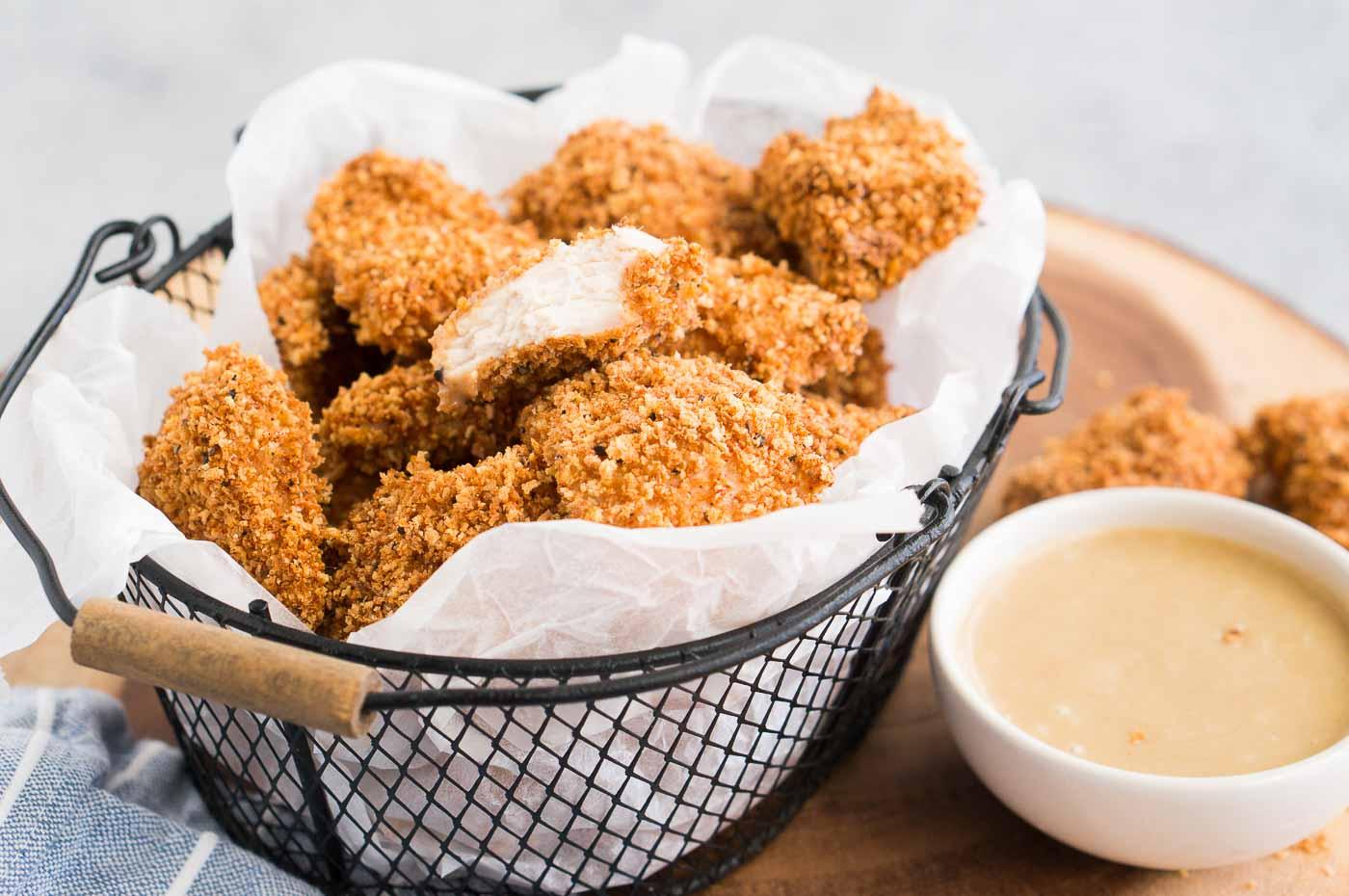 tender and crispy chicken bites in a basket